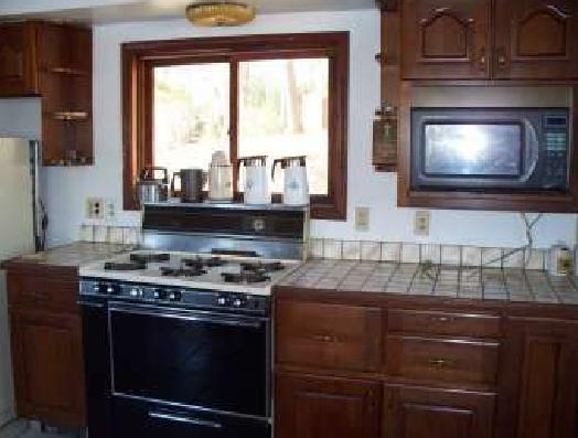 All cherrywood cabinets with plenty of room