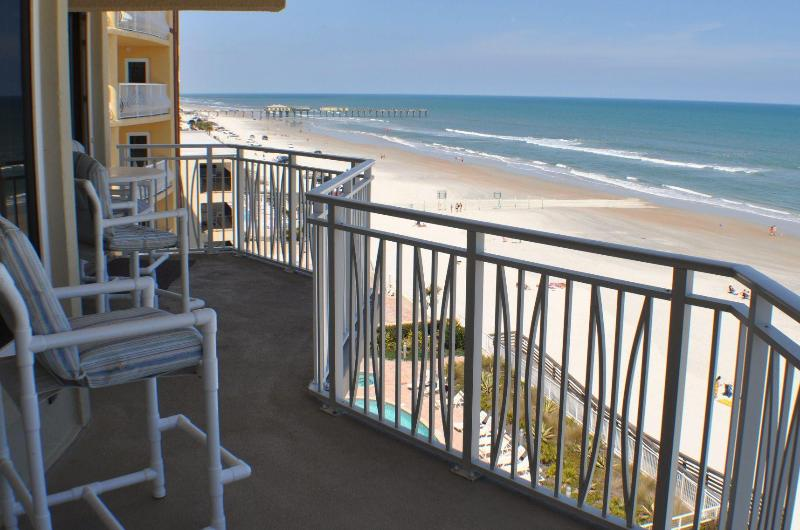 Oceanfront Balcony with table/stools and 2 reclining chairs/ottomans - looking north to Sunglow Pier