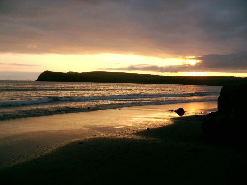 Sunset on the sandy beach near the house
