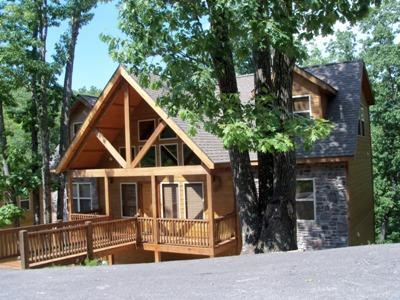 Front of our 5BR Lodge on a beautiful Wooded Lot
