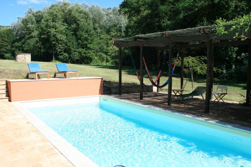 Pool, sun terrace and pergola