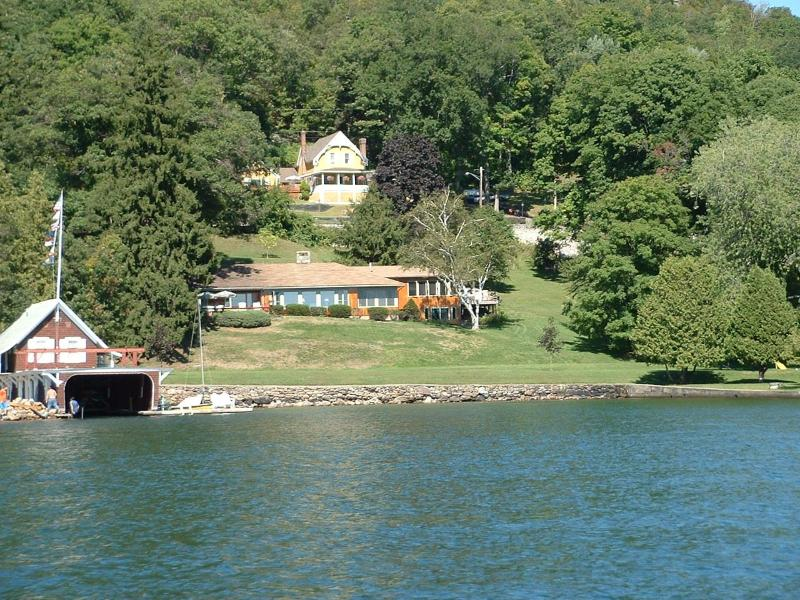 2 Unique & Beautiful homes.  Boathouse on the water and Big House on the bank.