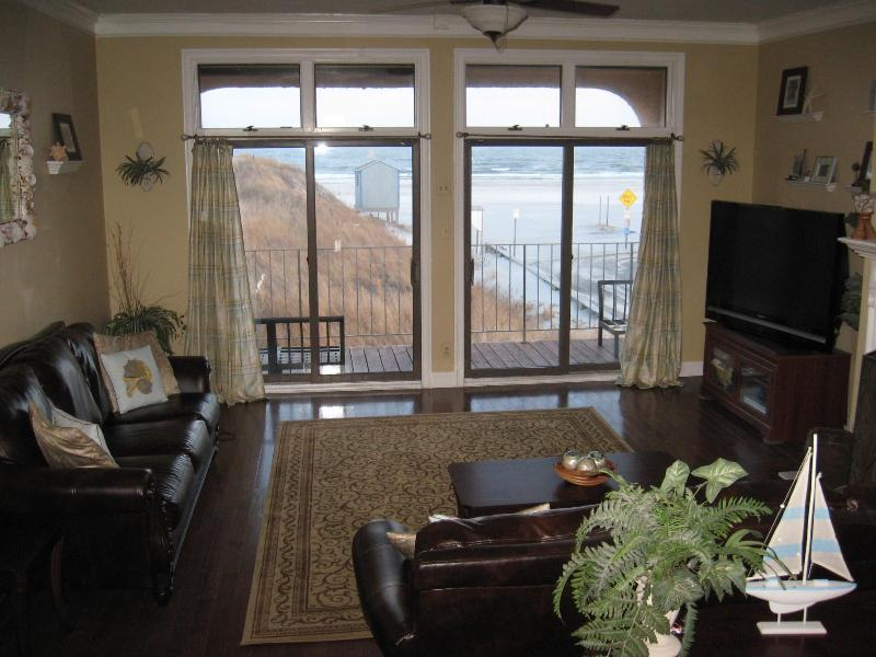 Large open family room with glass sliders to oceanfront deck!