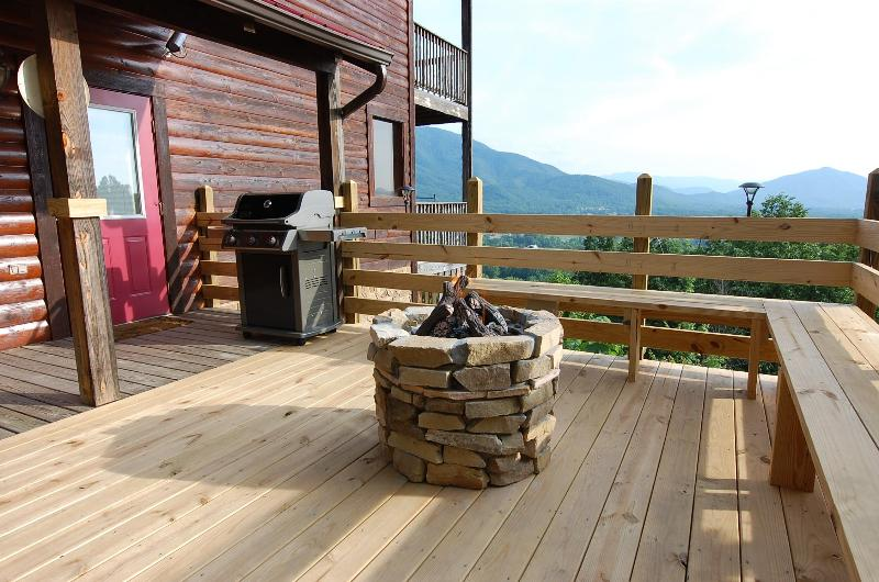 Walk out the door to a Gas Grill, Gas Fire Pit, Bench Seating, Speakers and a 30 Mile Mountain View