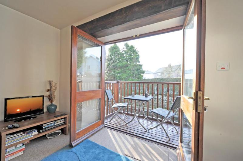 The comfortable lounge has a riverside balcony