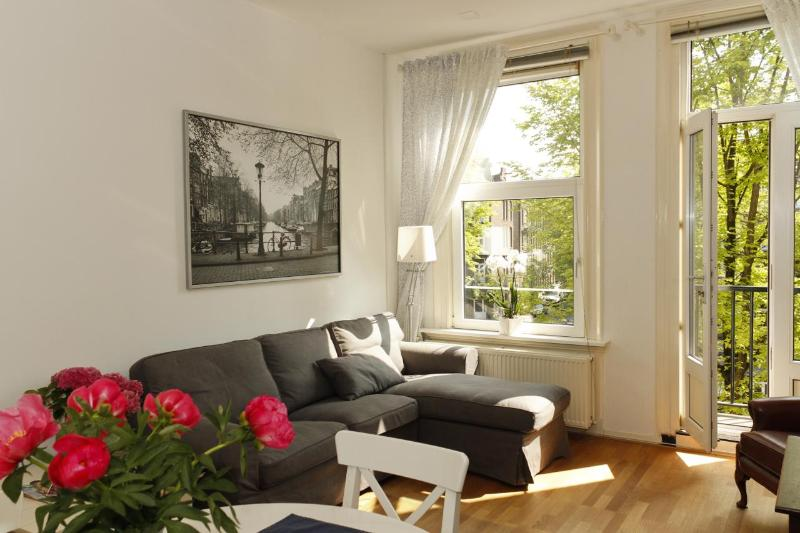 Living room with balcony facing the canal