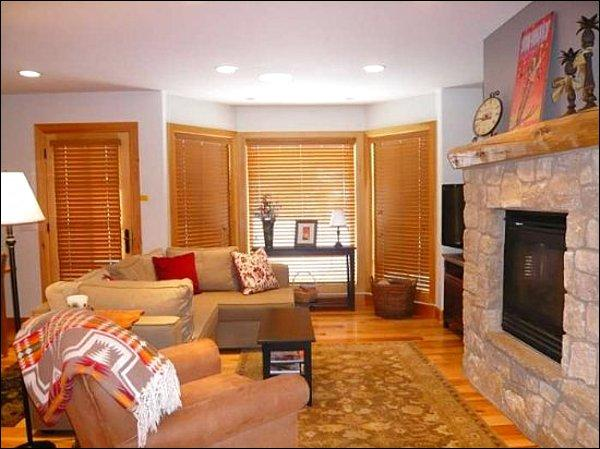 Spacious Living Area with a Gas Fireplace and Flat Screen TV
