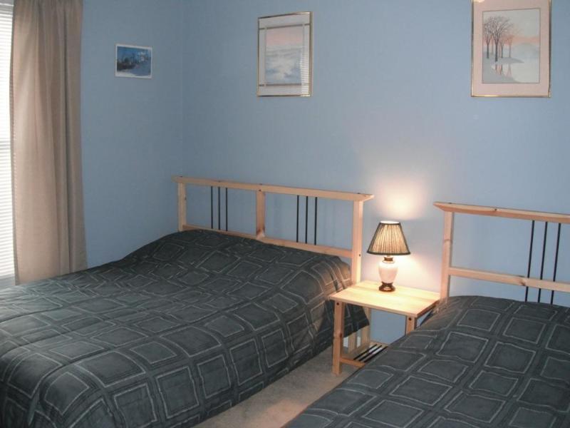 First floor bedroom with full and tween beds