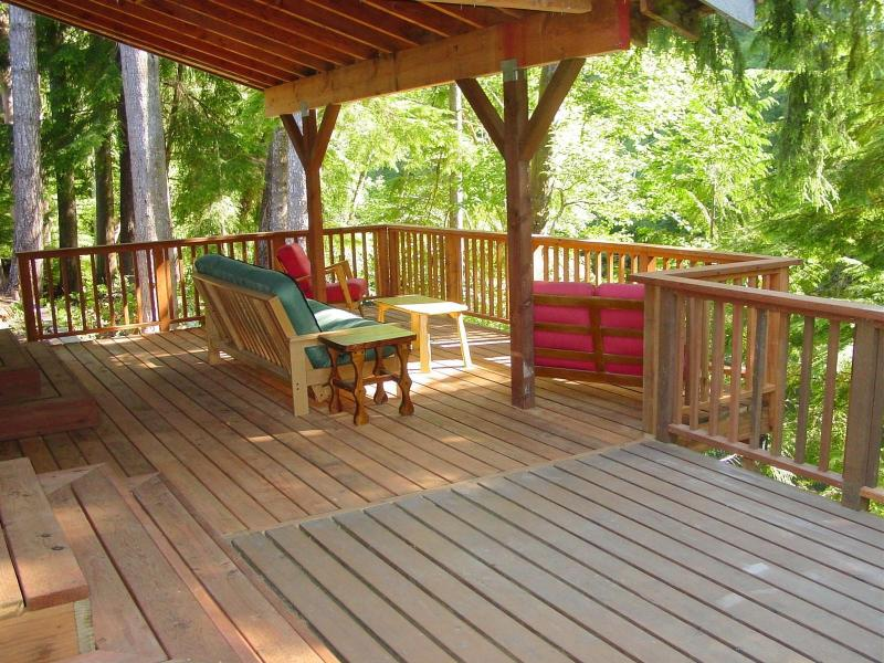 Covered and open-air back deck with river views!
