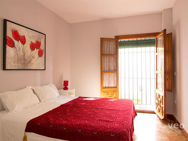 The bright double bedroom has a large window.