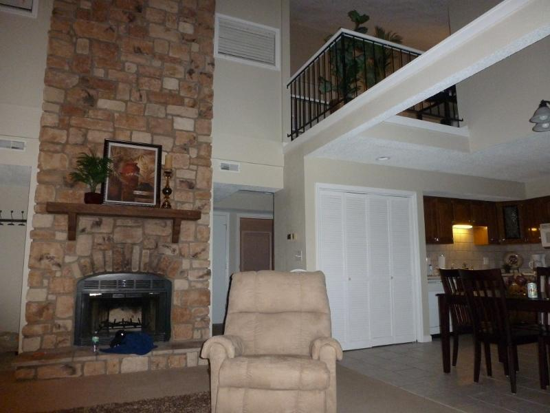 Large space with 2 story fireplace