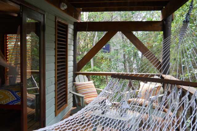 Relax in the hammock on the private deck of the Guava Suite