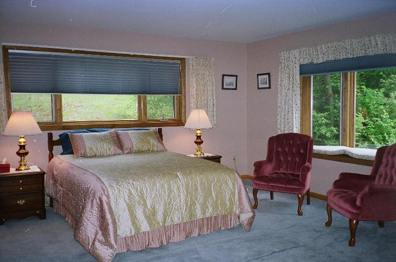 Master suite with comfortable sitting area, TV