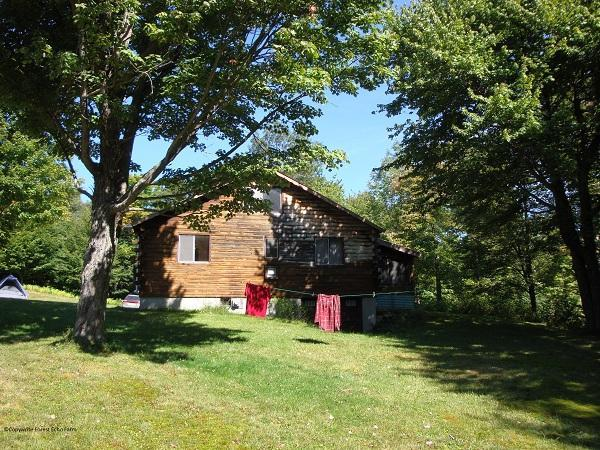 Ripley Hill Cabin is situated in a lovely meadow.