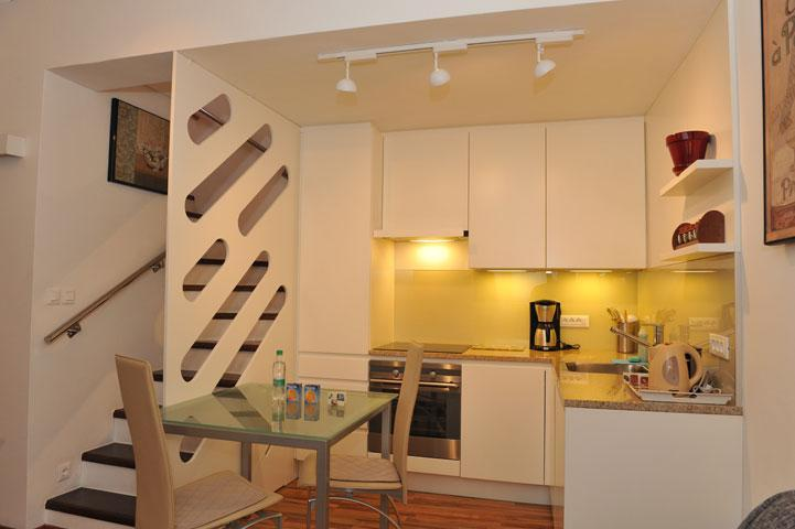 Apartment MIJA - Kitchen  and a dining corner with a table for three persons