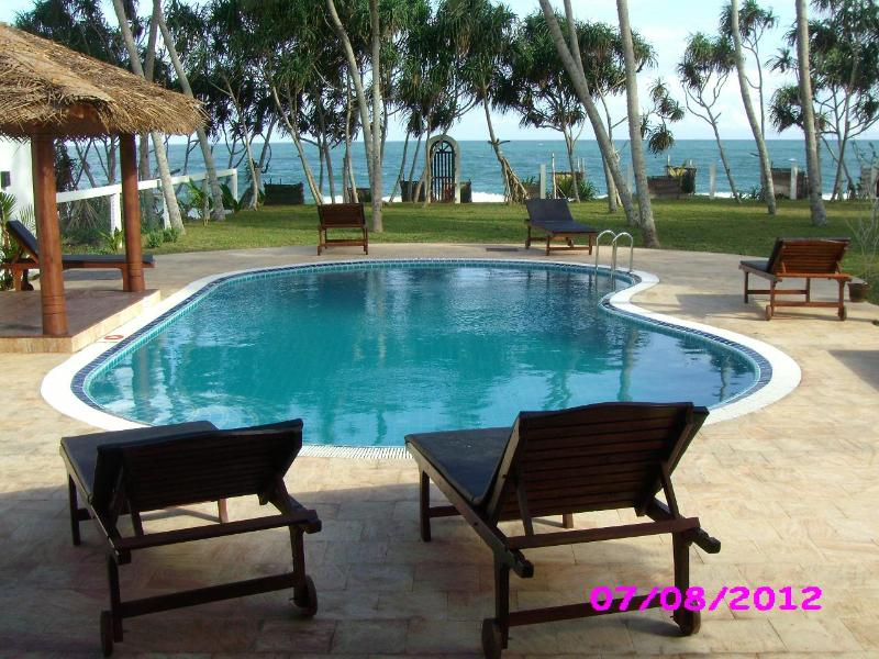 pool deck with sun beds