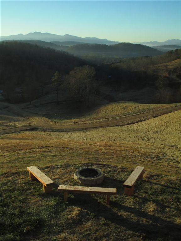 A fire pit with a great ridge view...and native spruce benches.