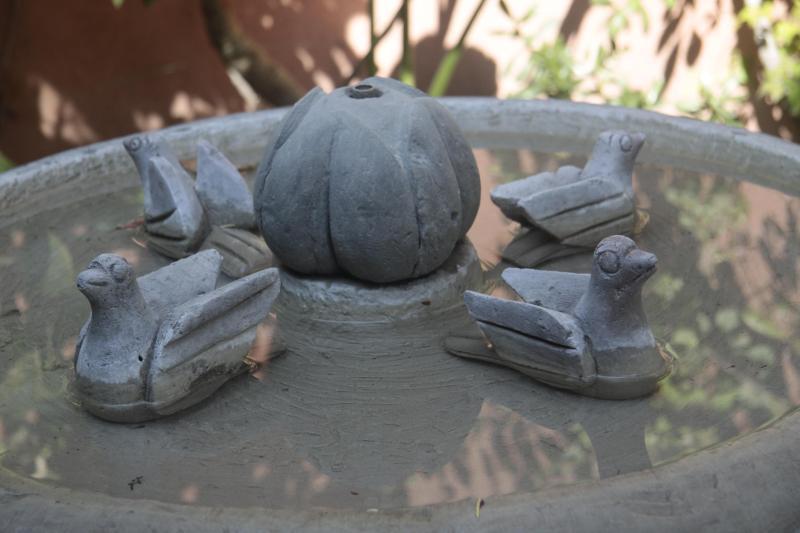 Stone birds in the courtyard fountain