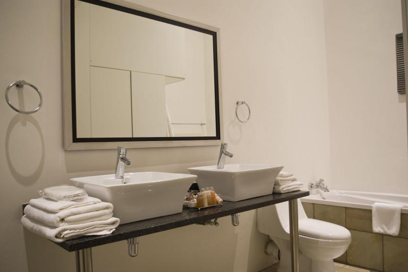 Bathrooms have shower & bath, twin basins