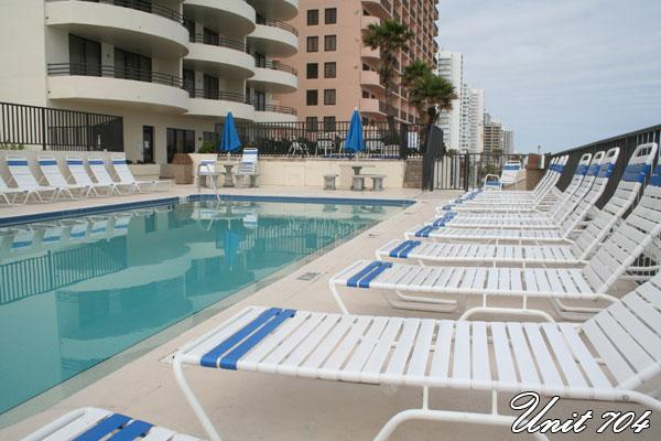 Pool lots of lounges Sun llmday