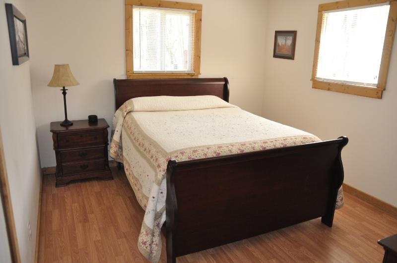 Master Bedroom with Queen Sleigh Bed and Dresser