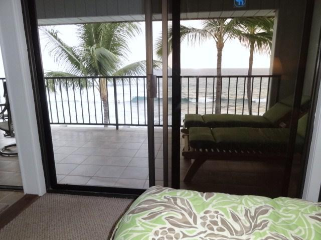 View from the huge king size bed looking out to the lanai and the ocean