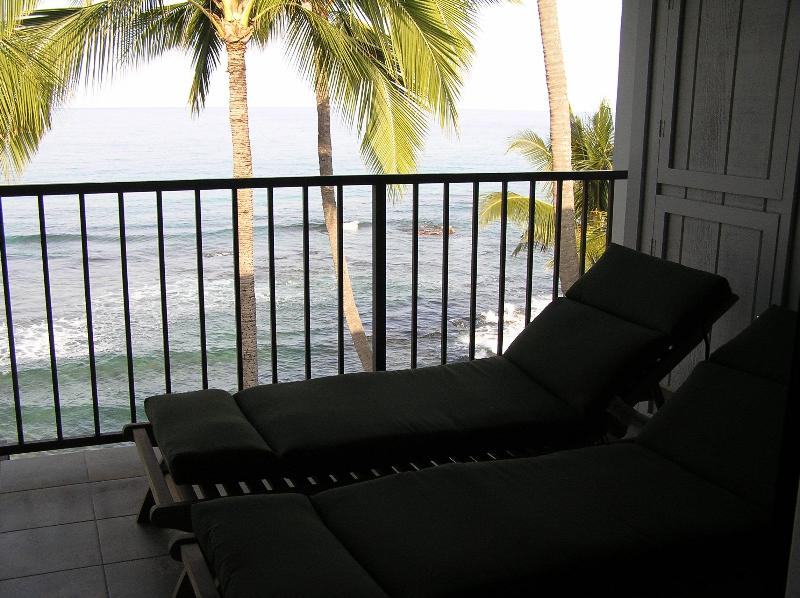 View of the lanai from the comfortable teak wood lounge chairs