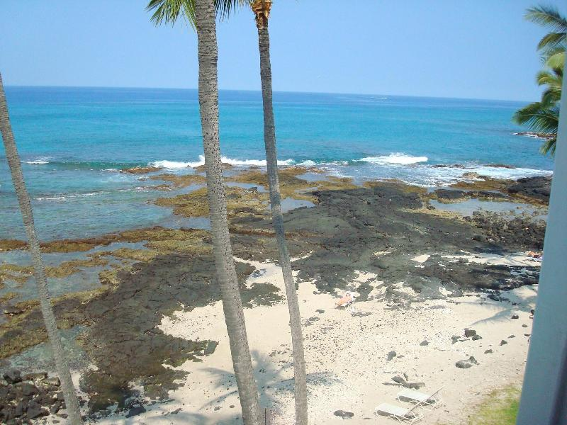View looking down at the beach and the tide pools from the lanai.  Where is that little Honu?  lanai
