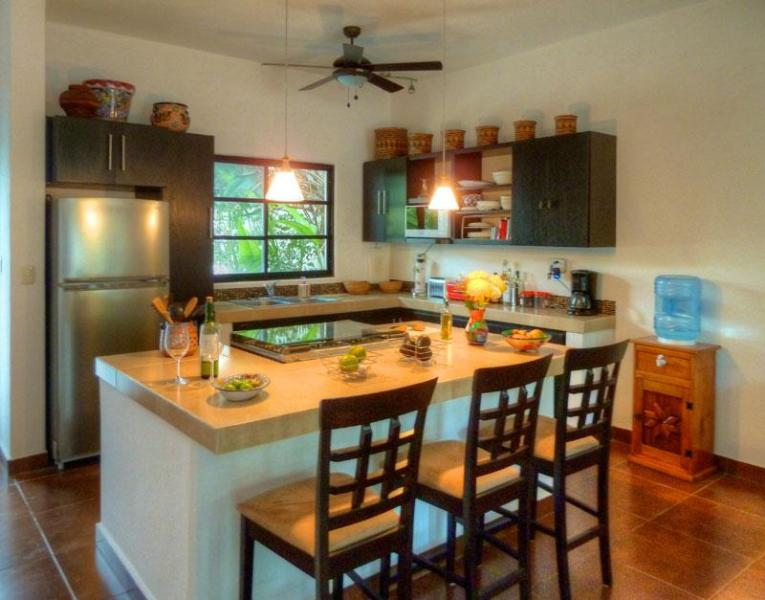 Fully equipped kitchen opens to dining room