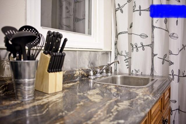 Solid Surface Countertop, French Country Tin Backsplash