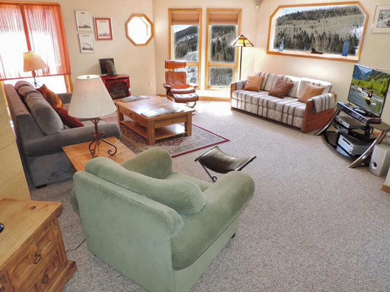 Living are has it all - recliners, sleeper sofas, high end entertainment system and mountain views!