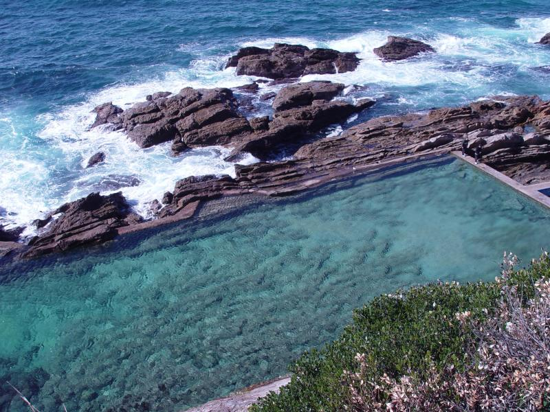 Bermagui's famous blue pool, washed clean by the ocean, great for snorkelling or whale watching