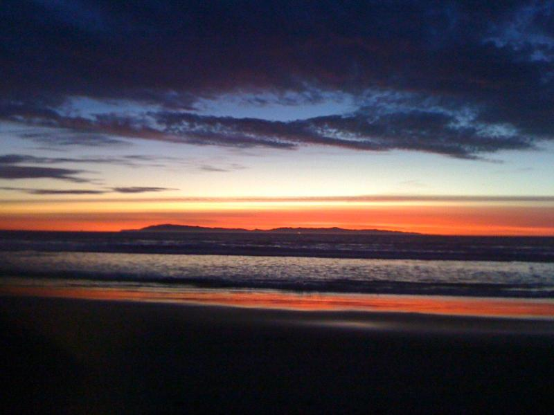 Sunset on the beach with Santa Cruz Island in distance.