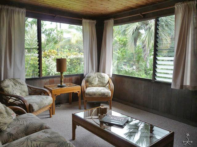 A comfy living room with garden & mountain views just a minute's walk to the beach.