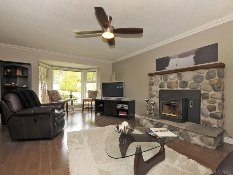 Living Room with plush carpet and pellet stove