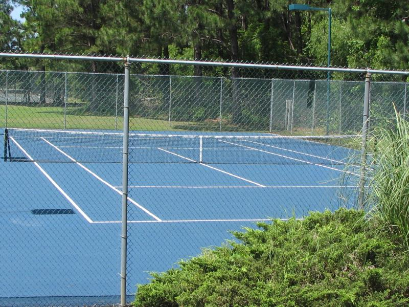 One of 4 outdoor Clay surfaced courts. Cement surfaced courts and 2 indoor courts also available.