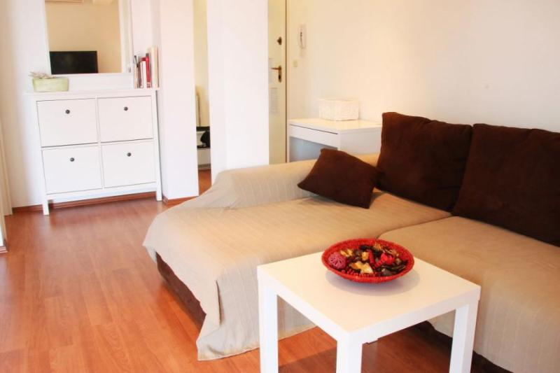 The apartment has a spacious open plan living-dining room area