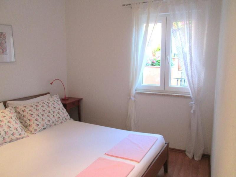 The bedroom is furnished with a French bed.