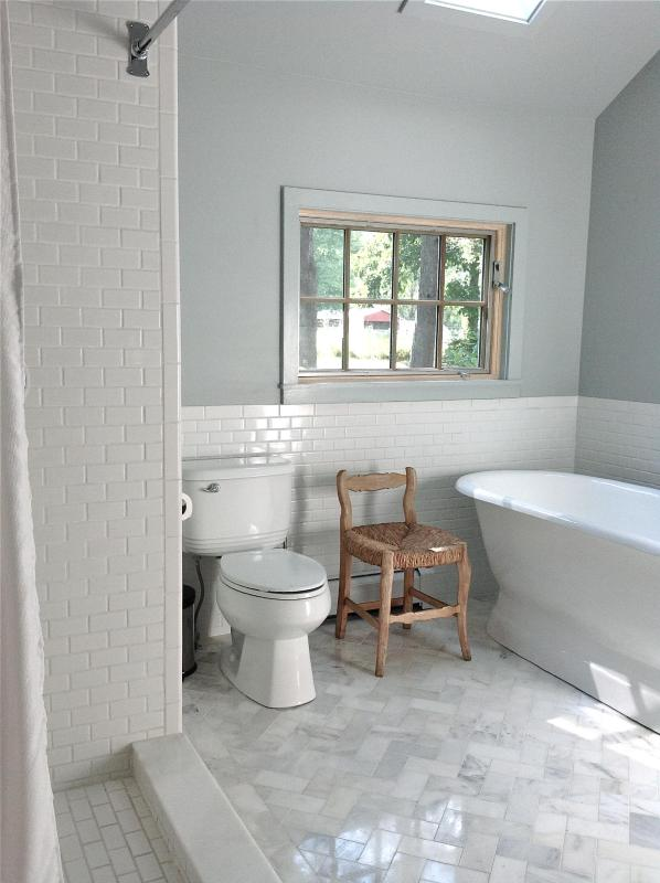New bathroom with bath and shower