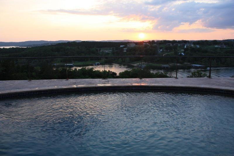 Gorgeous evening sunset out over the private pool and lake.