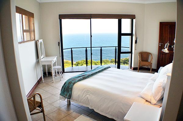 Main bedroom with balcony and unobstucted sea view