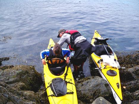 Guests arriving by kayak at low tide
