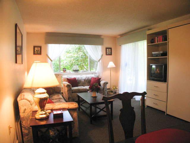 Living Room w/ Murphy Bed & Sliders to patio