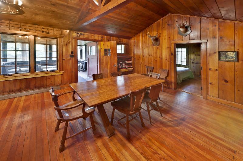 Rustic Dining room and Living room combined , all Knotty Pine