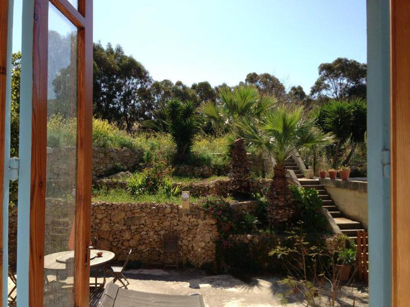 outdoor area leading to the fields belonging to the house