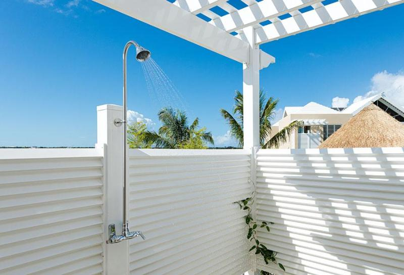 Outdoor shower cabana is handy to beach and pool