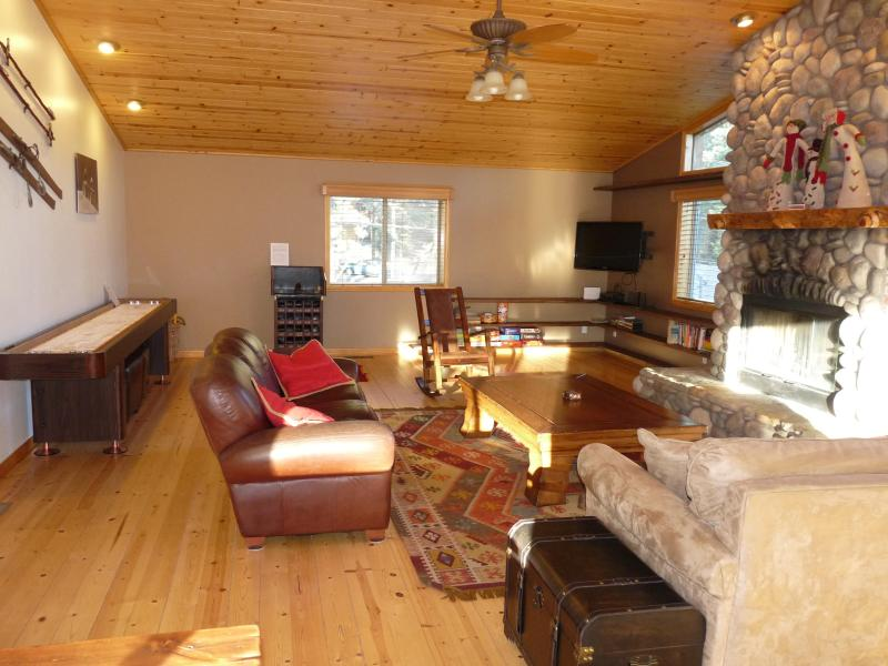 The 'Great Room'. Enjoy 12' shuffleboard, large stone fireplace, movies, & lots of natural light