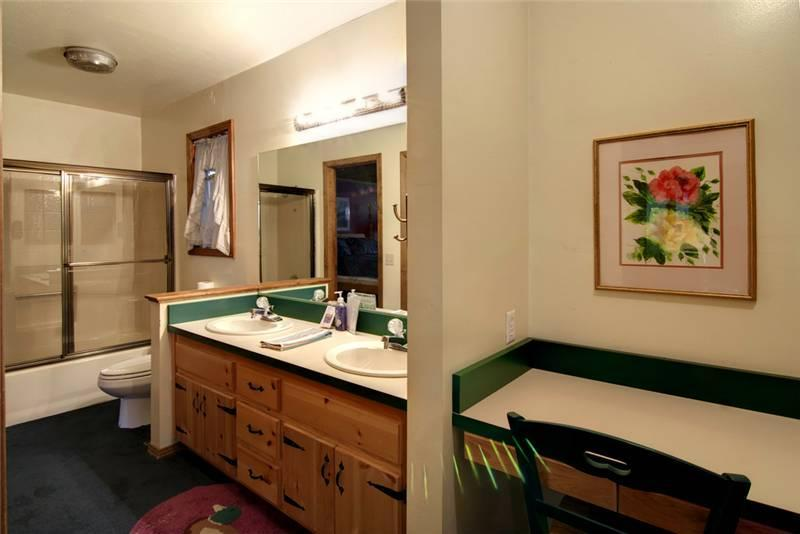 A master bathroom with his/her sinks and a dressing table, also with a walk-in closet!