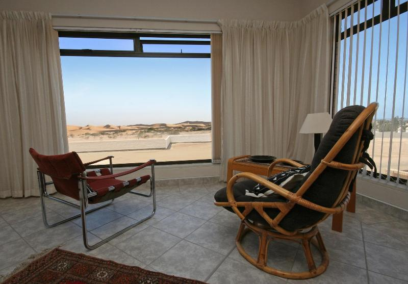 Lounge with view of dunes and atlantic ocean.