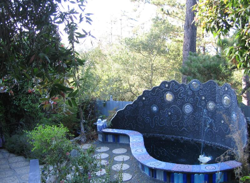Mosaic water feature, the entire front part is a bench!
